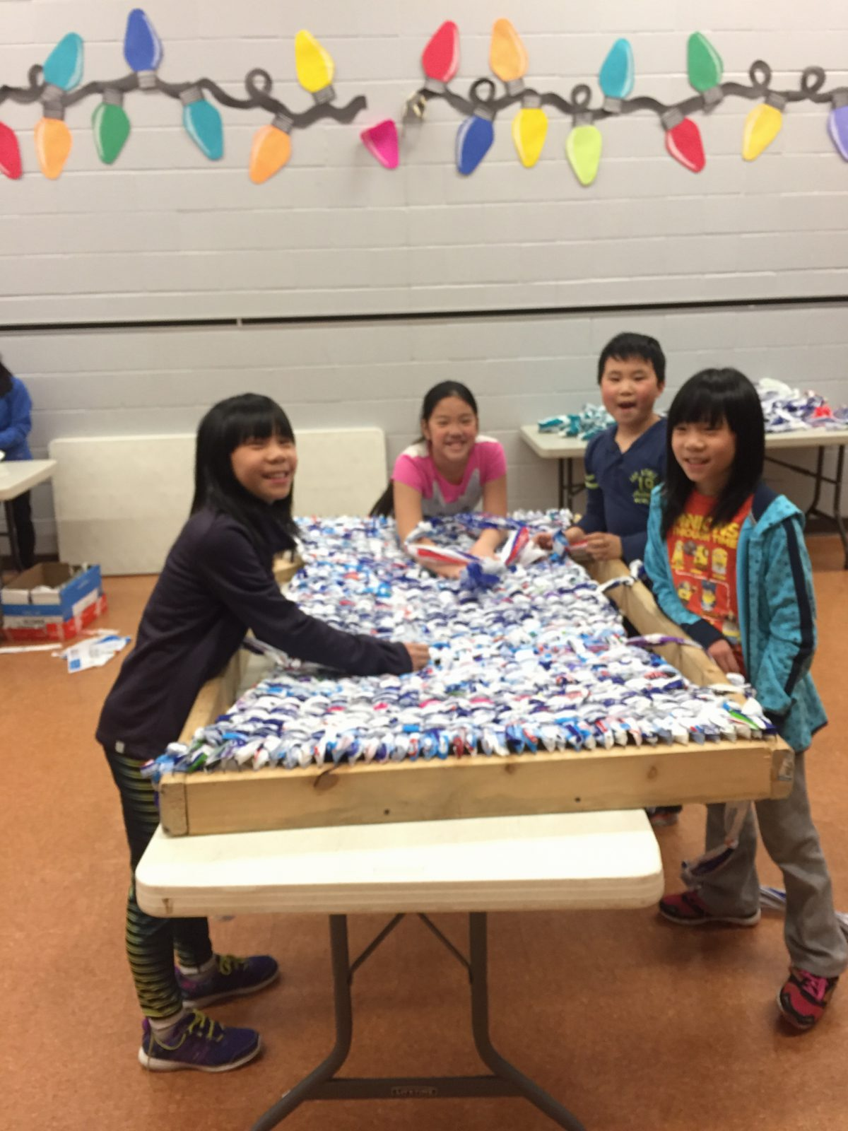 Our milk bag weavers hard at work.
